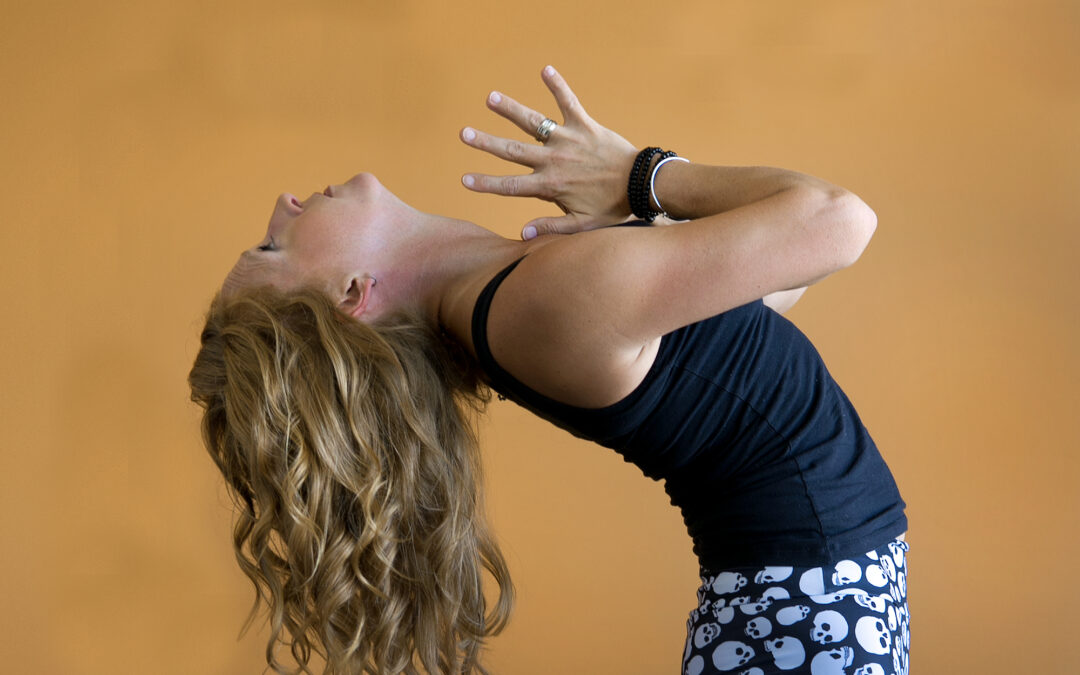 Spine fusion restores strength, flexibility for QC yogi