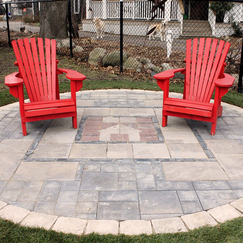 Stonework patio with inlayed design at Hospice Simcoe
