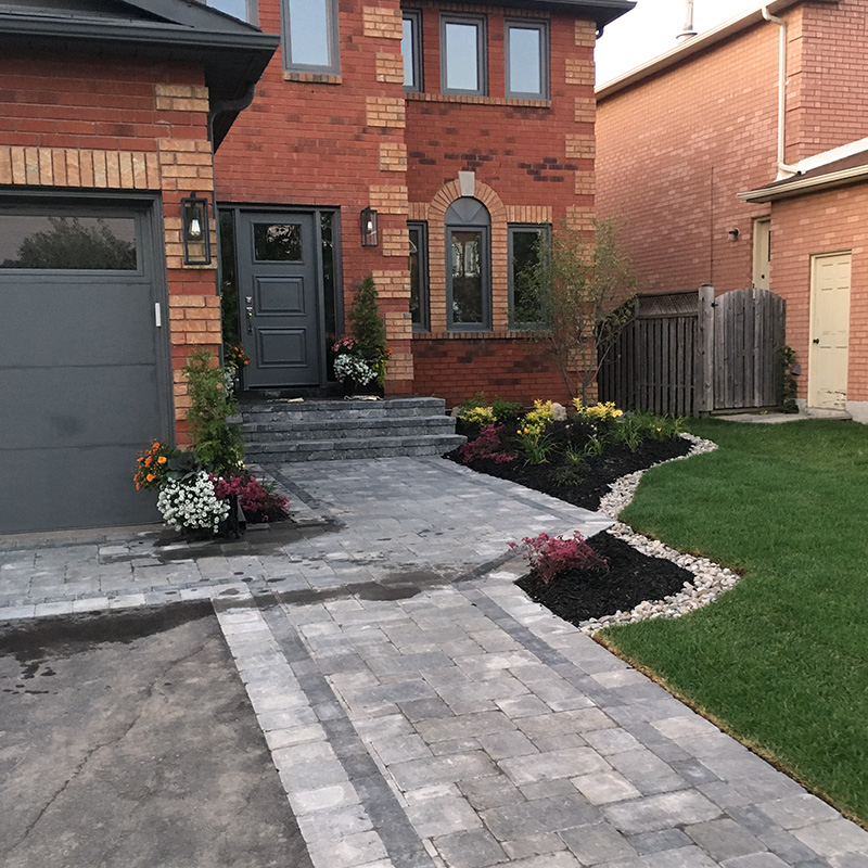 Stonework entry with new landscaping