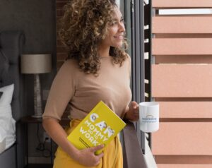 christinemichelcarter mockup-of-a-woman-looking-out-the-window-holding-a-15-oz-mug-and-a-book-28476