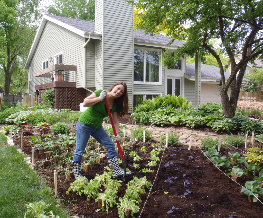 Shawna Coronado digging in her front lawn vegetable garden