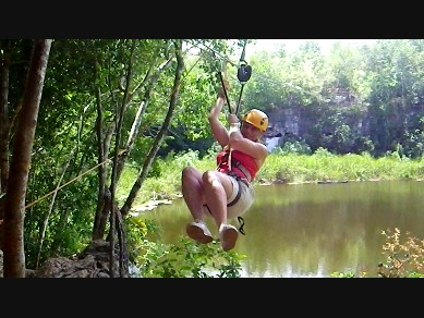 Mexican jungle, ziplining over a crocodile pit