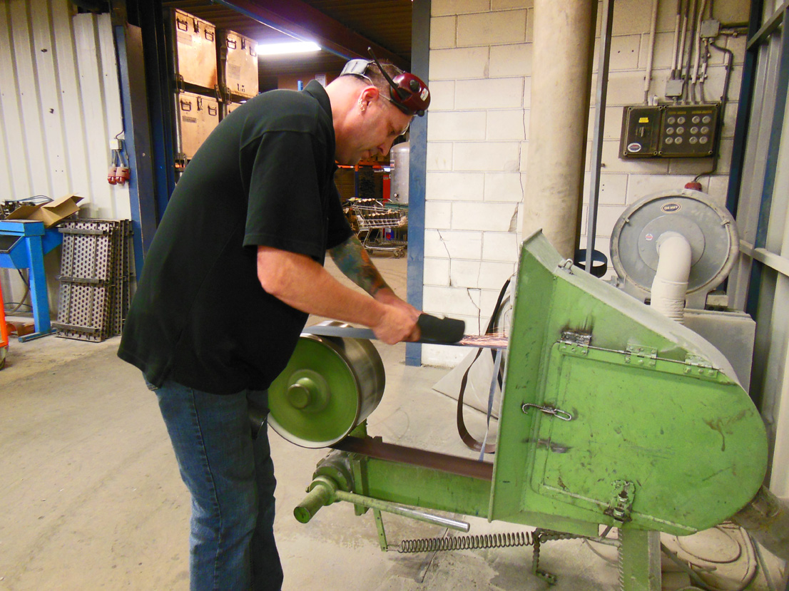Garden tool being sharpened in the DeWit Tool factory.