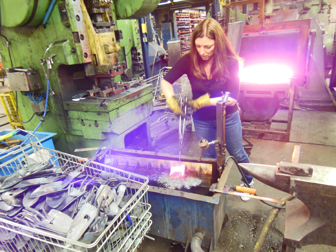 Shawna cooling the forged curved tool.