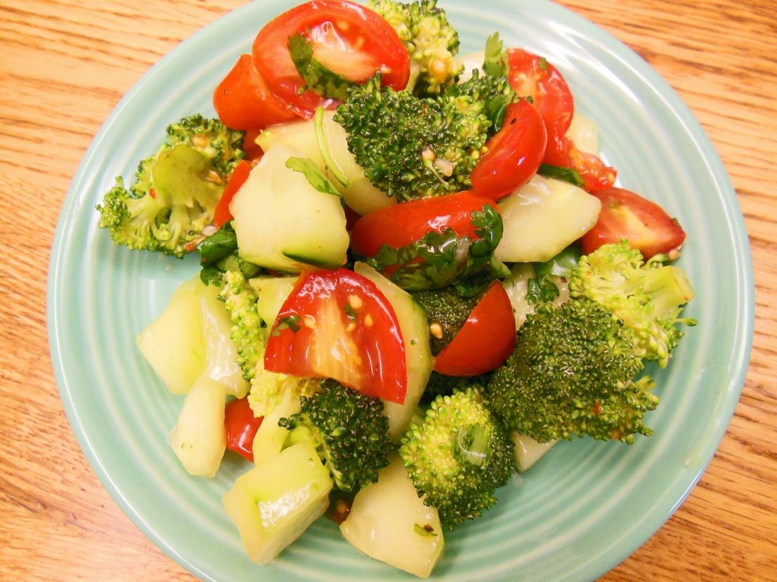 Broccoli tomato cucumber cilantro salad