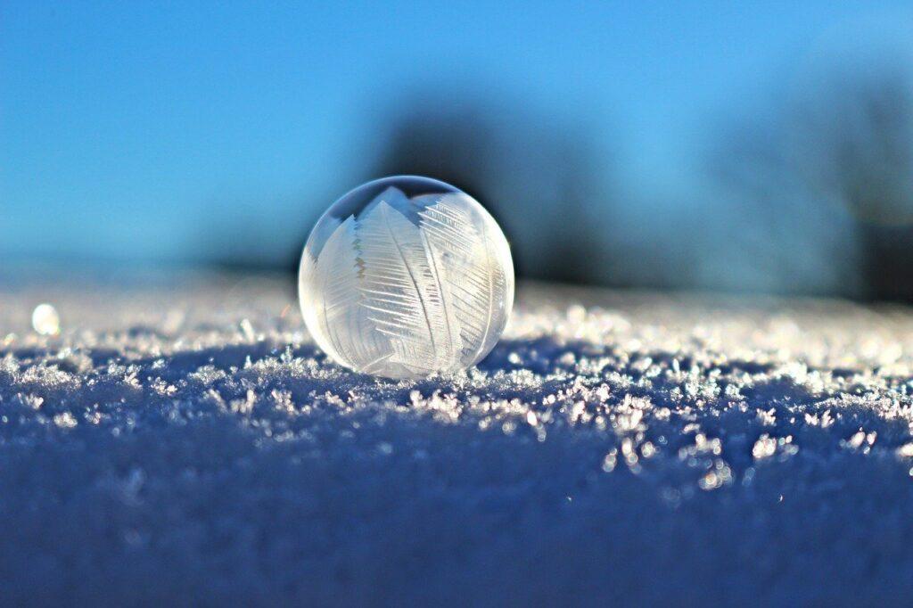 Frozen soap bubble in snow