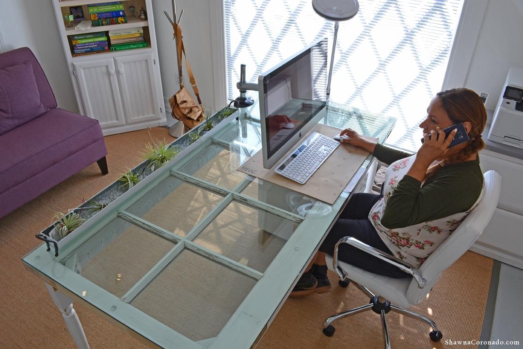 Shirley Bovshow Door Desk on phone