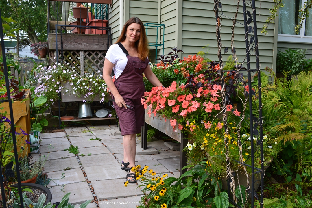 Rosies Workwear Overall Eggplant in Garden with Shawna Coronado