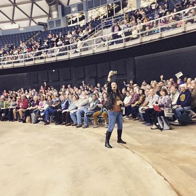 Shawna Coronado speaking at a stadium