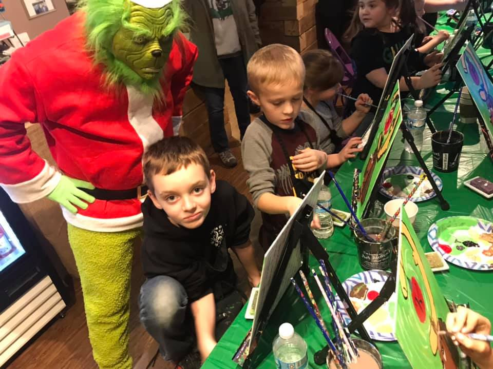 Public paint party for kids with The Grinch.