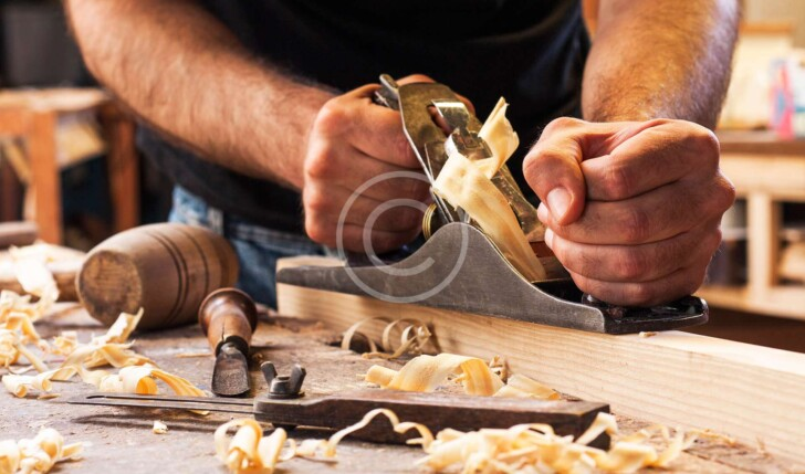 Man carving wooden board