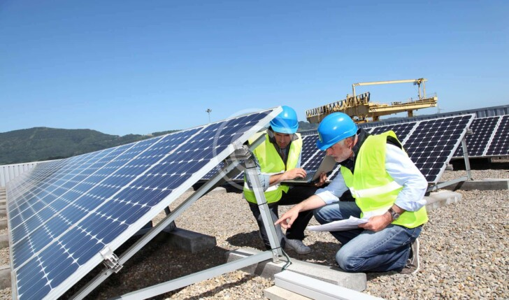 workers discussing solar panels
