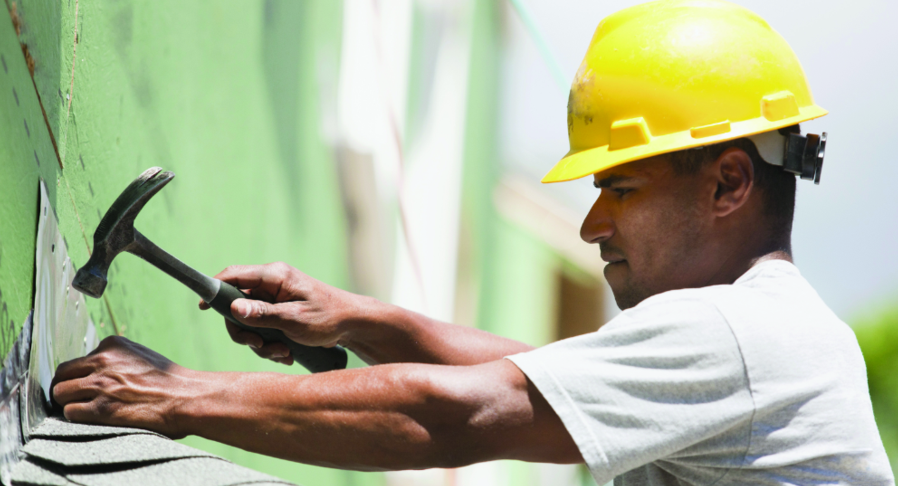 Image of Man Working On Roof