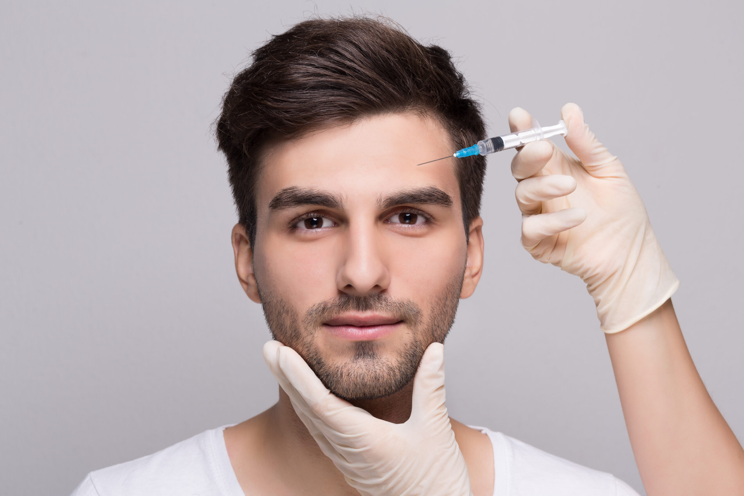 Man receiving botox injections