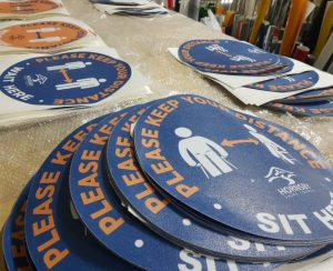 Round stickers for social distancing signage