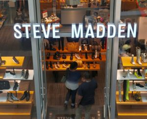 Steve Madden sign and shoppers at retail store