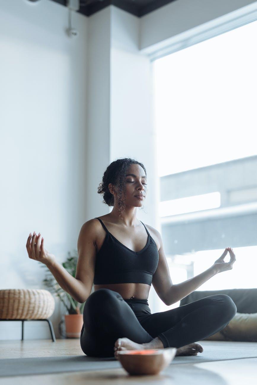 a woman doing a mudra pose