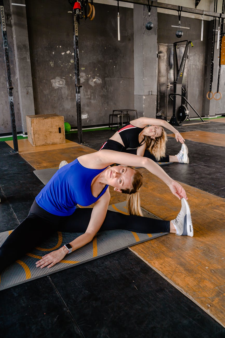 photo of women doing stretching
