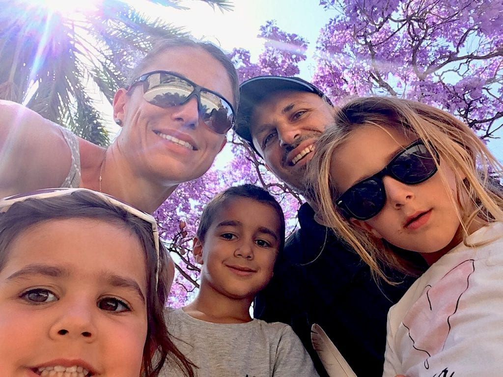 Blooming Tree in Malaga The Difference Between Travel And Vacation | Travel vs. Vacation | Difference Between Vacation And Travel | Long Term Travel With Kids | Worldschooling | #travel #travelvsvacation #vacation #longtermtravel #frugalforluxury #worldschooling #travelingwithkids #familytravel