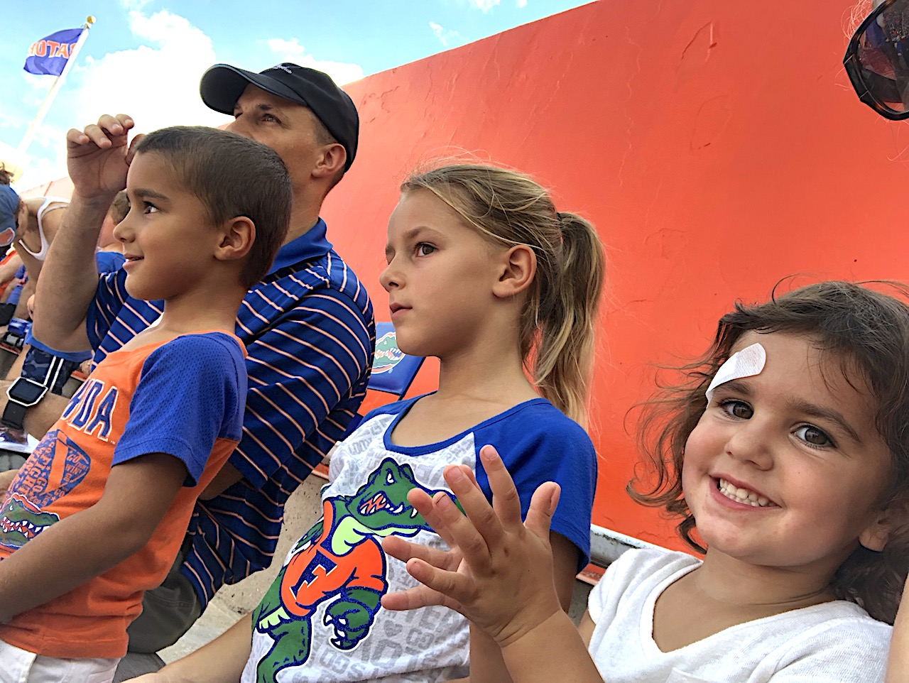 Family at UF Sports Event - 2-day itinerary for families in Gainesville, FL #gainesville #florida #tourofflorida #alachuacounty #gainesvilleFL #universityofflorida #UF #gogators #Gainesvillewithkids #gainesvilleitinerary