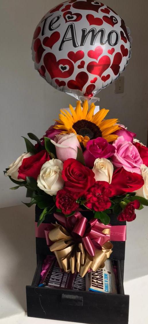 Regalo con flores y chocolates