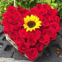 Arreglo floral en forma de corazón