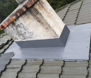 A roof that is in good condition but has a chimney that is cracked, mouldy, and is about to be replaced
