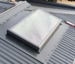 A completed skylight by Newton Roofing installed on a corrugated iron roof.