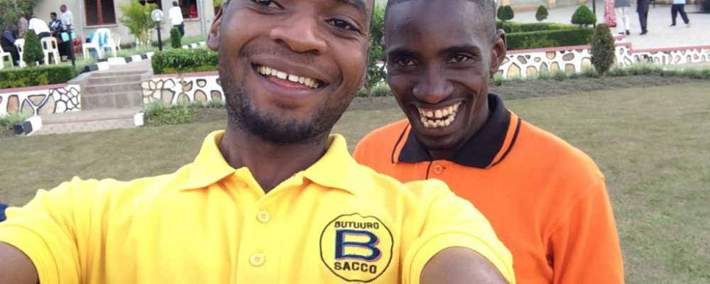 Staff members Joshua and Amos enjoy a light moment at a stakeholders' retreat