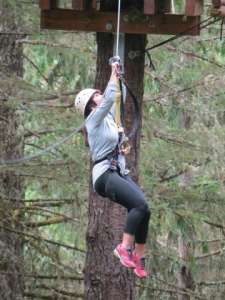Julie hanging from a tree