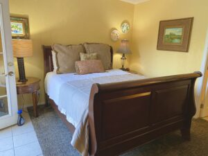 The queen bed in suite 5 with nightstands on either side.