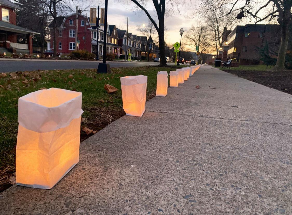 Luminaria Kits lining a sidewalk