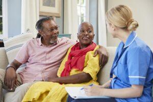 Home Care Nurse Visits Elderly Couple