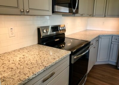 Kitchen with white subway tile and White G granite