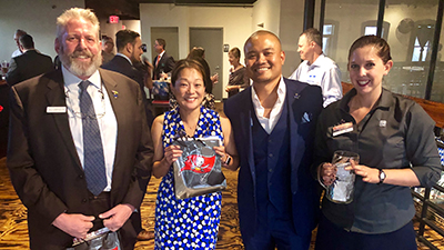 Door prize winners Paul Suppicich  of Maney   Gordon   Zeller, PA. and Lisa Reeves, Engel & Völkers, with Rod Gaerlan, Tampa Bay Buccaneers/ RMBTB president, and Vicky Prescott, Image Depot Express/RMBTB Membership Chair.