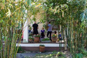 Yoga Teacher trainees on porch