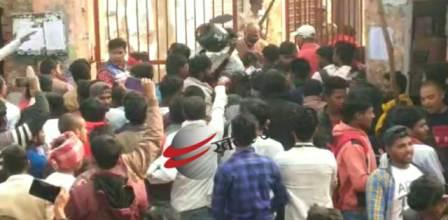 Examiners forcibly beat the guards for entering the examination center