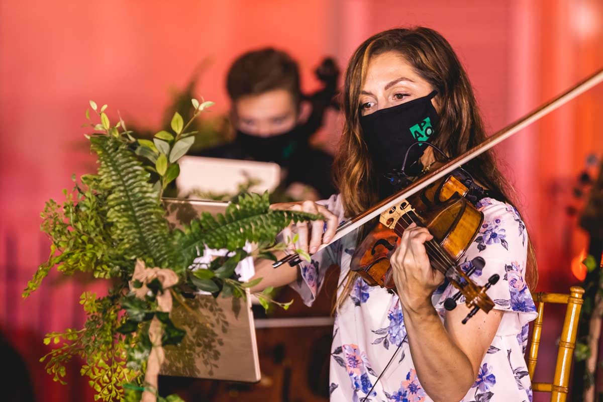 Violinist wears mask and performs