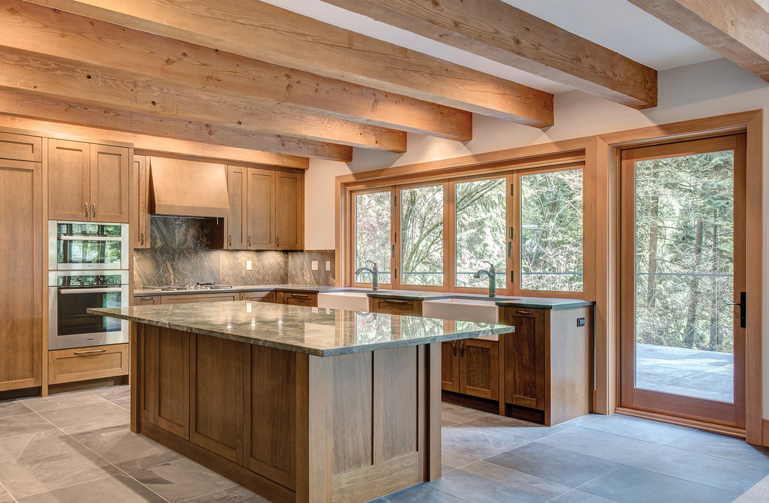 Beautiful kitchen with wood windows, door, and mouldings