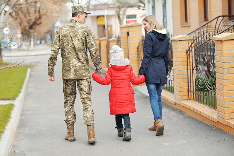 Military Family Walking Down the Street