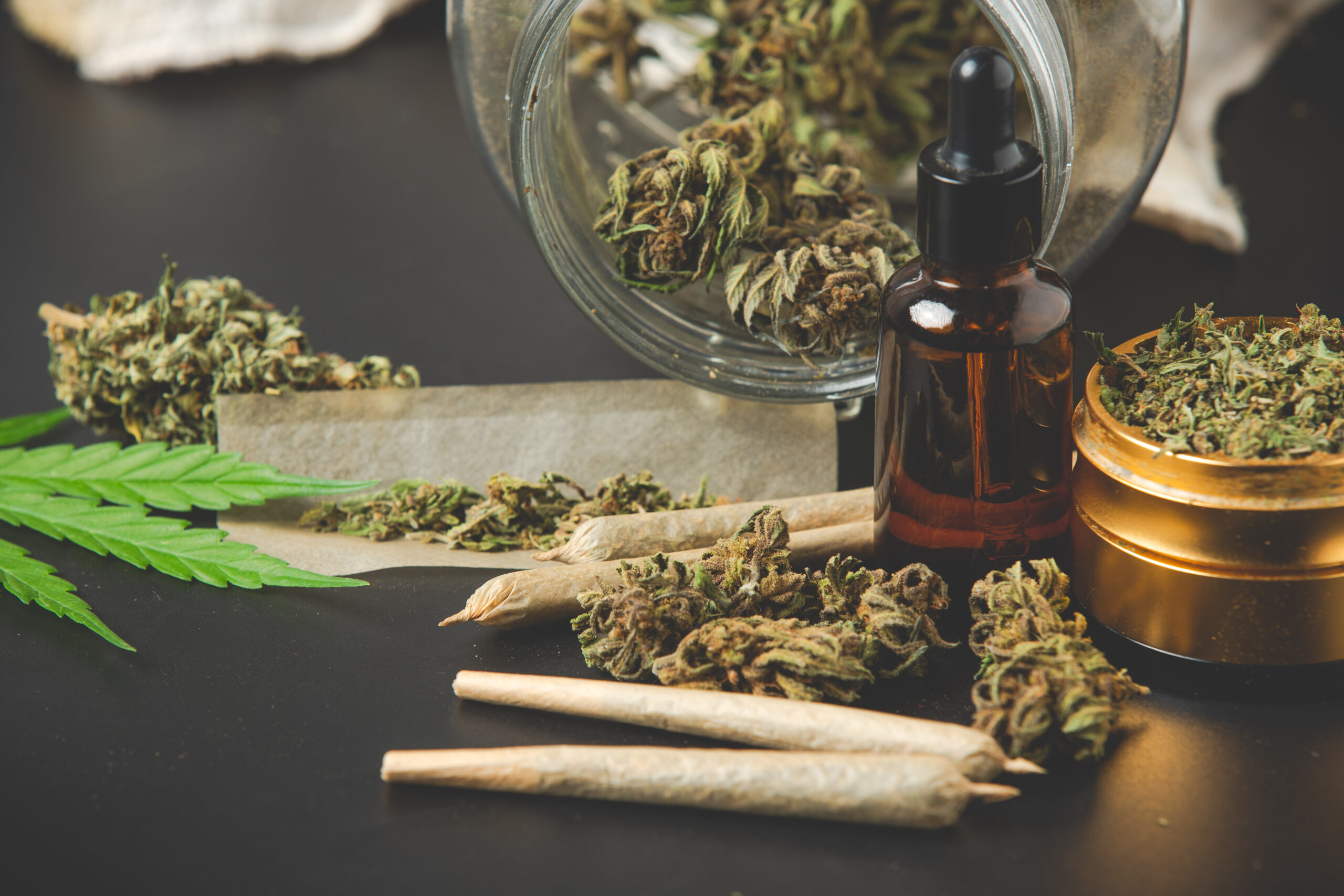 Marijuana buds with marijuana joints and Cannabis oil