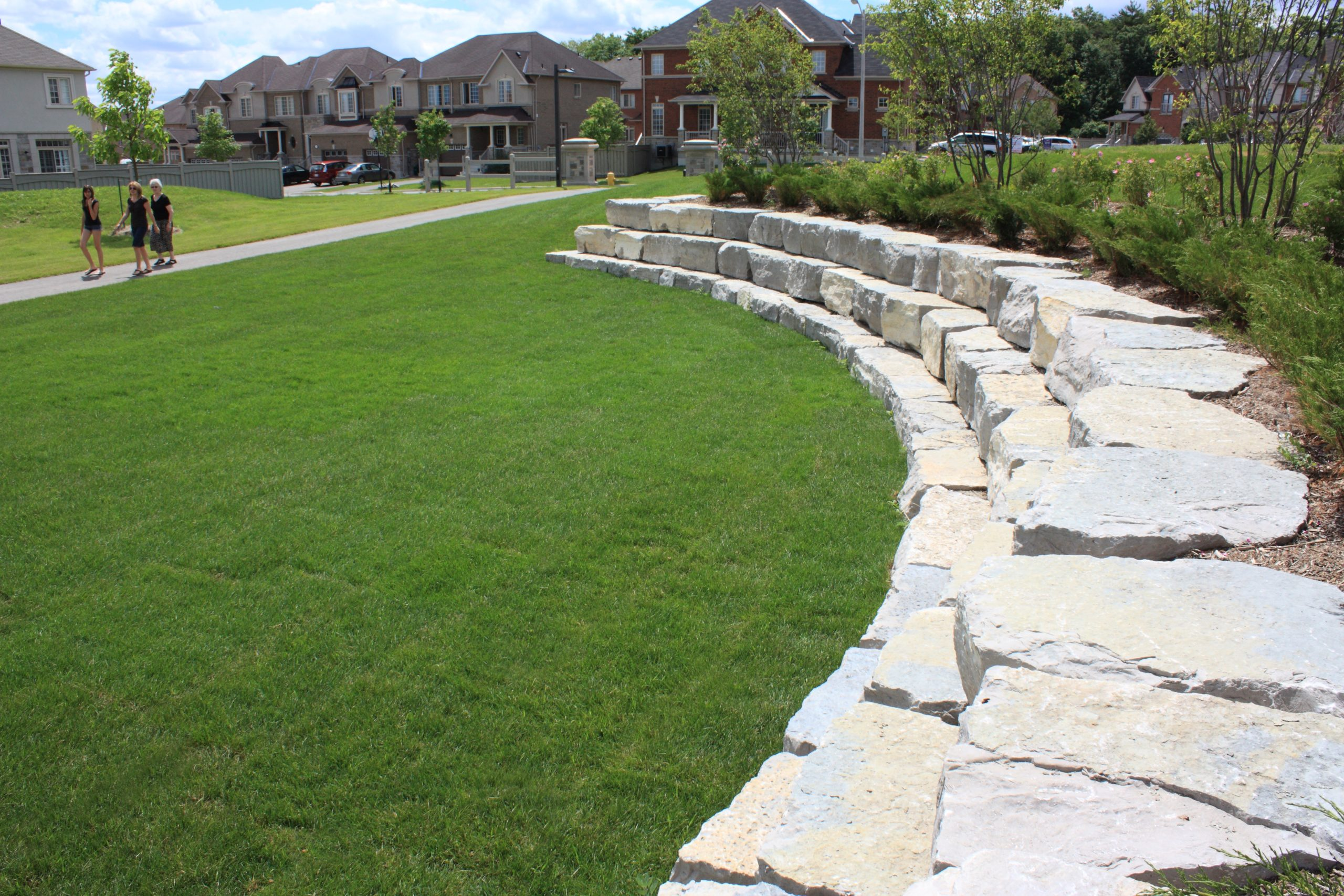 Large curved stone retainer wall.