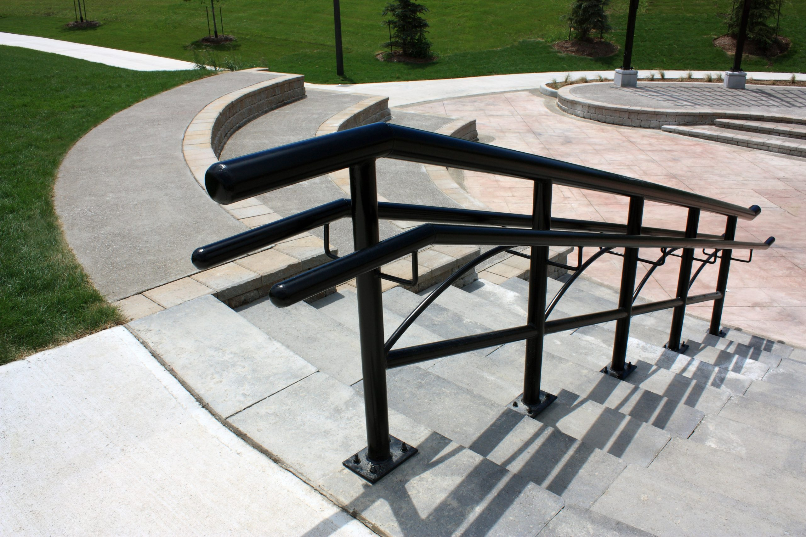 Stone staircase with metal handrail