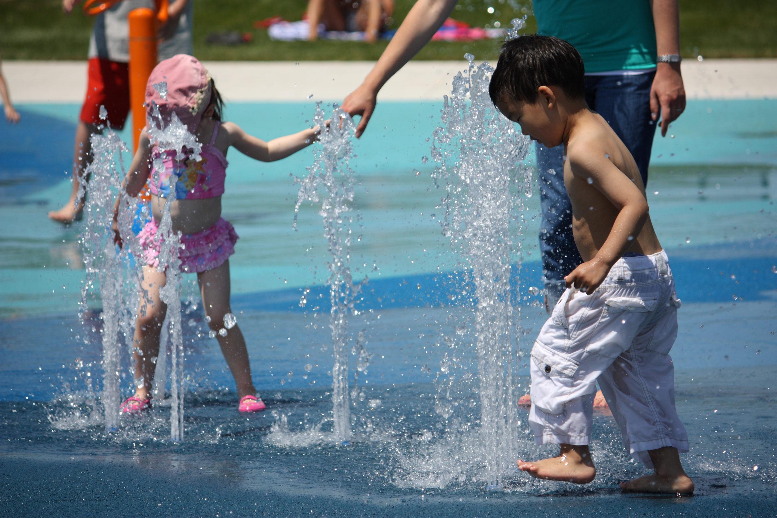 Children playing in a splash pad.