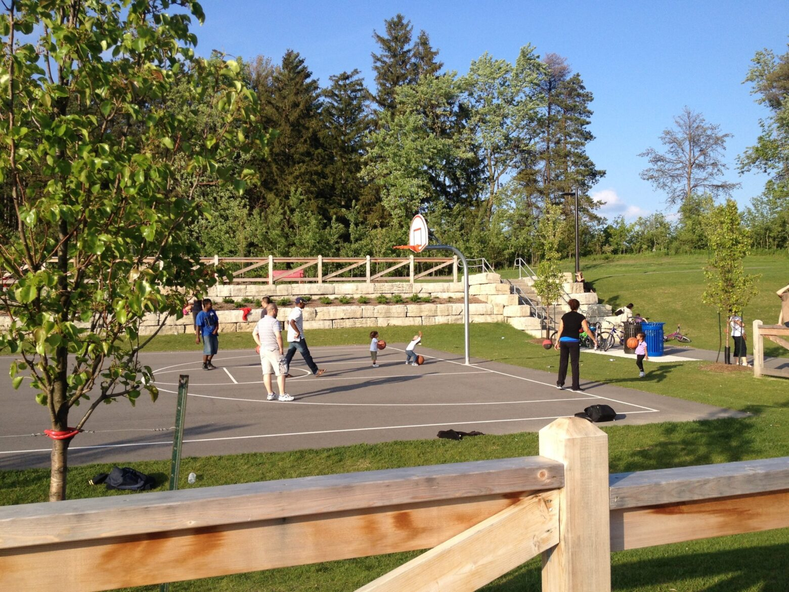 People playing basketball in a court.
