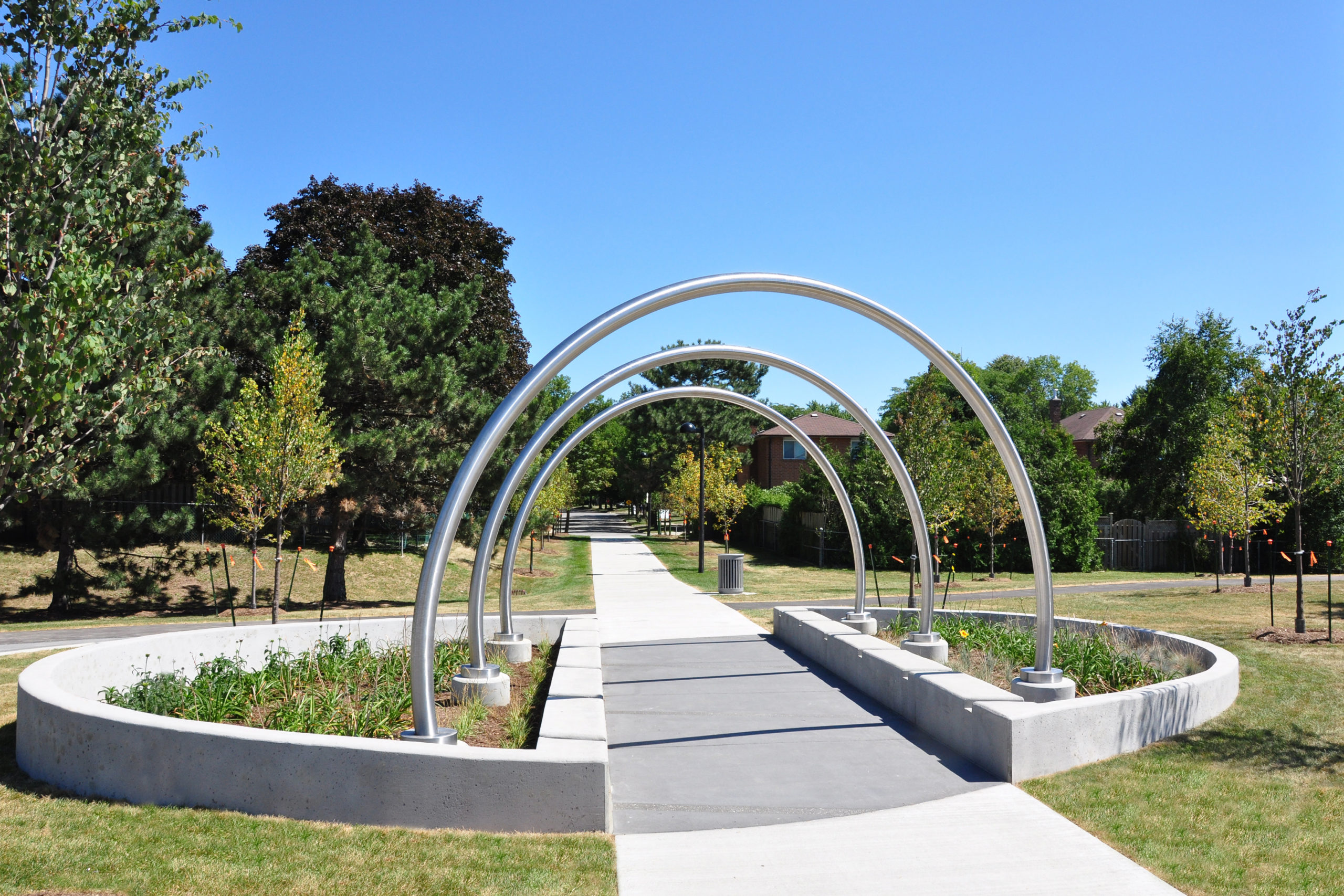 Pathway into park with metal loops.