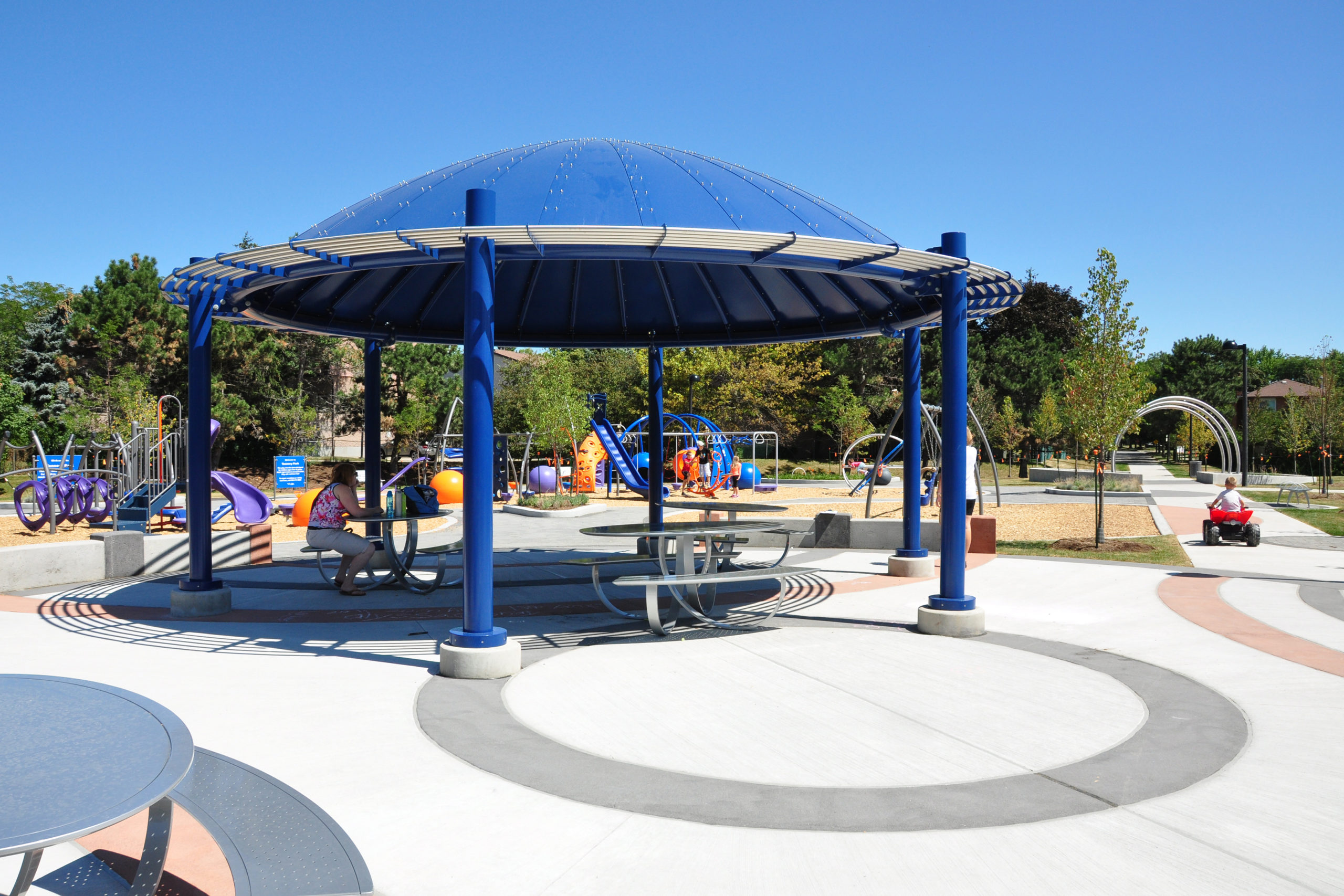 Shade structure with childrens playground.