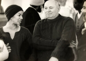 Image - Peg Alston with Romare Bearden at an art reception with other artists. circa 1977