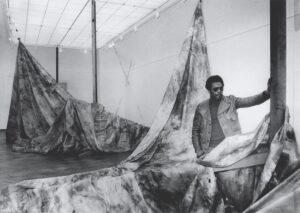 Sam Gilliam with his 1973 painting Autumn Surf. Courtesy ~ SFMoMA