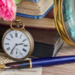 Image Antique pocket clock on vintage books and letters background ID40697280©Neirfy|Dreamstime.com